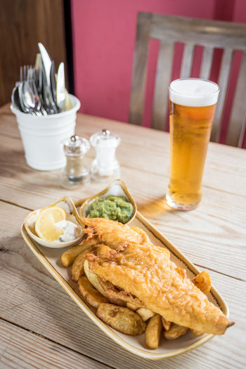 High Angle View Of Meal Served In Plate With Beer On Table
