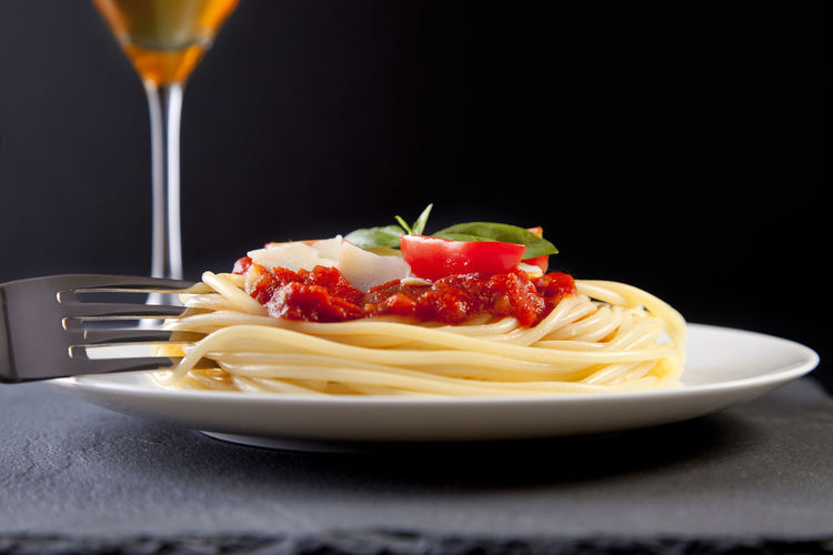 Menu Black Background Close-up Food Food And Drink Fork Freshness Healthy Eating Indoors  Italian Italian Food No People Pasta Plate Ready-to-eat Recipe Red Restaurant Savory Food Spaghetti Studio Shot Table Tomato