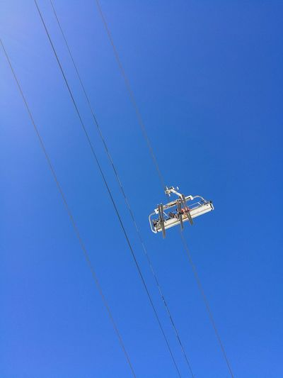 Blue Flying Clear Sky Day Sky Ski Ski Lift No People Airshow Nature Outdoors Animal Themes Drone