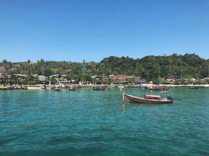 Arriving at Koh Phi Phi Longtail Boat Phiphiisland Thailand Water Sky Nautical Vessel Waterfront Clear Sky Copy Space Transportation Mode Of Transportation Outdoors Travel