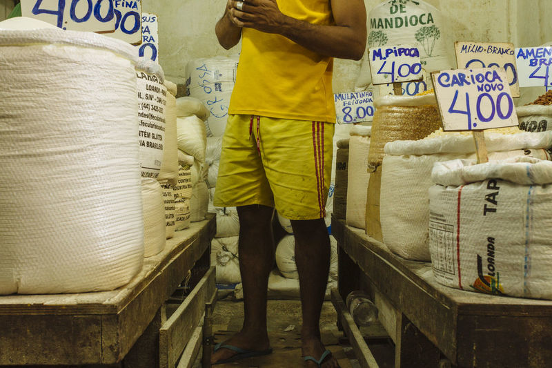 manioc flour seller contacts his customers to advise of promotions Low Angle View Paint The Town Yellow Street Vendor Street Market Feira De São Joaquim Fresh Food Low Section Streetphotography