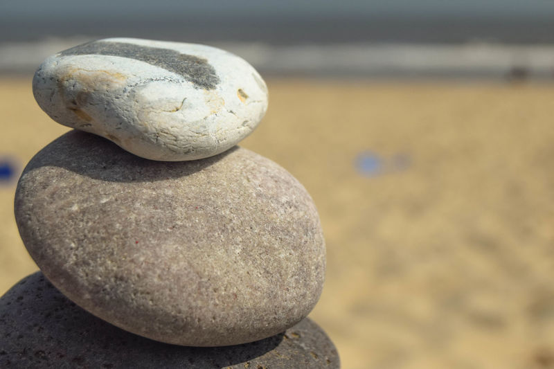 Pebble Stack Pebble Stacking Solid Stone - Object Rock Stone Land Beach No People Rock - Object Pebble Zen-like Nature Balance Stack Outdoors Focus On Foreground Close-up Sand Day Art And Craft Sea Still Life Space For Text Space For Copy Beach Photography