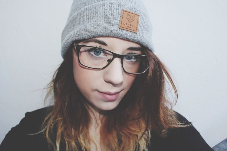 EyeEm Selects Eyeglasses  Looking At Camera Front View One Person Portrait Glasses Young Adult Young Women Beautiful Woman Real People White Background Lifestyles Gravity Photography Vintage Style Woman Portrait Photoshoot Sylt Young Woman Young Wild And Free(; Face FaceShot Blue Eyes Beanie