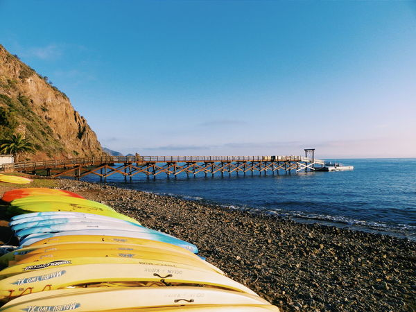 Blue Wave Canoe Blue Sky Water Sea Nature Island From My Point Of View Catalina Island  Travel Beautiful Catalina Mountains  Outside Shore View Sky Sand Catalina Scenery Life Ocean Blue Sunrise Rock Pier