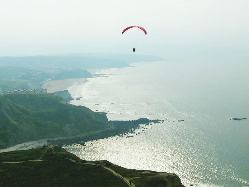 Aerial View Sea Landscape Beach Adventure Horizon Sand Outdoors High Up Cloud - Sky Scenics Sky Vacations Wave Day Nature Paragliding No People Hot Air Balloon Parachute