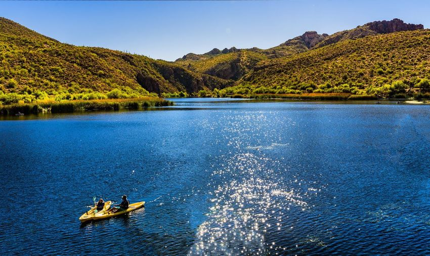 Recreational play Mountain Water Transportation River Mode Of Transport Nature Beauty In Nature Day Scenics Outdoors Waterfront Real People Sky Rowing Landscape Majestic Lake View Lake Kayaking Desert Arizona