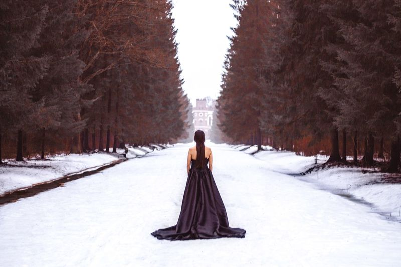 Snow Winter Cold Temperature Tree Plant White Color Nature Covering Scenics - Nature One Person Real People Day Beauty In Nature Clothing Field Full Length Land Direction Outdoors Warm Clothing