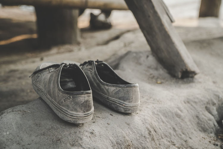 Shoe Pair Focus On Foreground Still Life Close-up Absence Outdoors Selective Focus Old Abandoned Land Two Objects Nature Personal Accessory Dirt Fashion Obsolete Compatibility Rubber Shoes Rubber Shoes And Pants