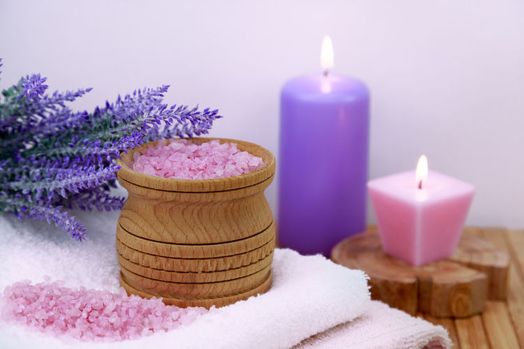 sea salt on a wooden table in the bathroom, concept - body care No People Nobody Rustic Aromatherapy Bath Candle Natural Pink Salt Wellness Bathroom Beauty Care Crystal Freshness Health Healthy Indoors  Ingredient Mineral Organic Pampering Purple Sea Spa Towel Towels Treatment White Wooden Exfoliation