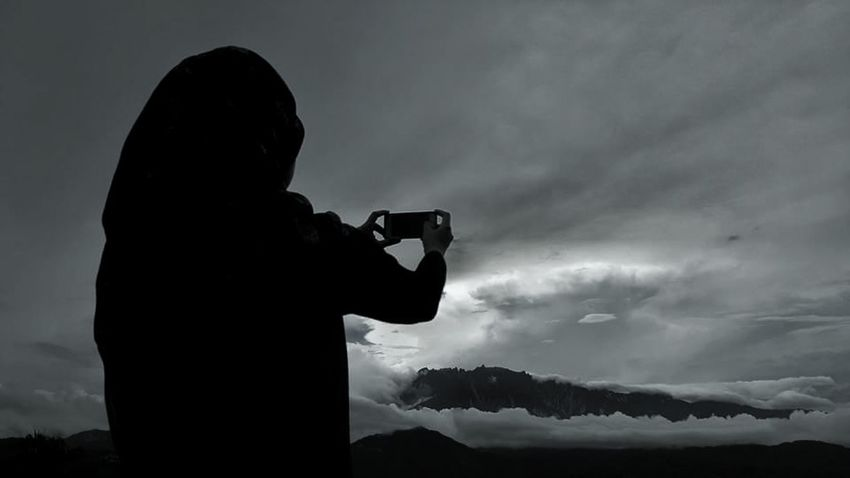The Hidden Kinabalu Mountkinabalu Ranau Randagong Sarayo Open Sky Photography Themes Photographing Camera - Photographic Equipment Holding Silhouette Landscape One Person Technology Digital Camera People Modern Outdoors Home Video Camera Adult Digital Single-lens Reflex Camera Nature Close-up Sky Adults Only Filming