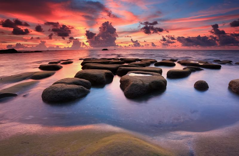 A beautiful sunset with mossy rocks in long exposure mode Mossy Rock Landscapes Seascapes Beautiful Nature Long Exposure Photography Nik Najmuddin Photography Kudat Borneo Malaysia Tindakon Dazang Beach Sunrise Sunset Water Sea Beauty In Nature Nature Beach Sky Scenics No People Outdoors Tranquil Scene Tranquility Horizon Over Water Day