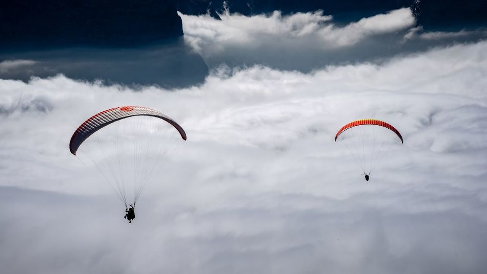 extreme sports paragliding in front of snowcapped mountains, Swiss Alps, Bernese Oberland, Switzerland Leisure Activity Sky Extreme Sports Paragliding Parachute Cloud - Sky Swiss Alps Alpine Alps Snowcapped Mountain Peak Summit Jumping Travel Mountain Alpen Berge Holiday Vacations Activity Action People Snow Blue Sky Sport EyeEmNewHere