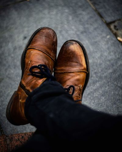 It's possible to make everything into a cool photo Low Section Standing Men Human Leg Shoe Pair Brown Close-up Leather Shoemaker