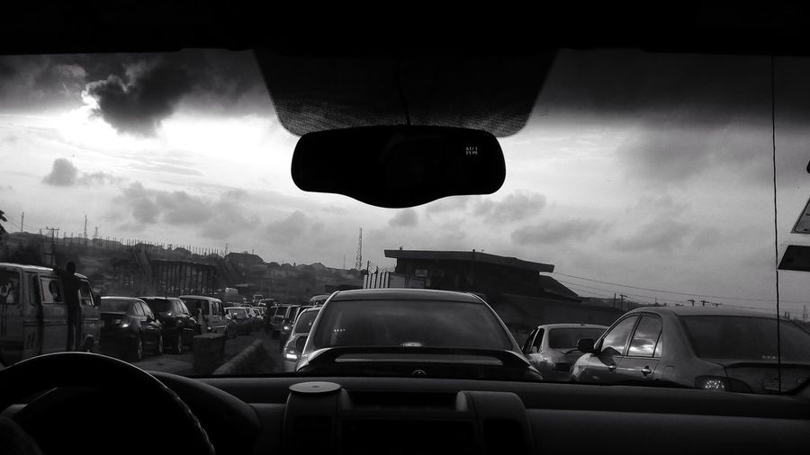Busy streets and traffic. Through the windshield. The Street Photographer - 2018 EyeEm Awards Busy Streets And Traffic Streetphotography People EyeEm Awards 2018 Lagos Nigeria Land Vehicle Car Windshield Road Sign Sky Cloud - Sky Traffic Jam Rush Hour Car Interior Steering Wheel Dashboard Passenger Seat Car Point Of View Traffic
