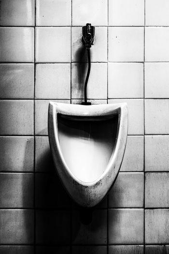 Urinal On Wall In Bathroom