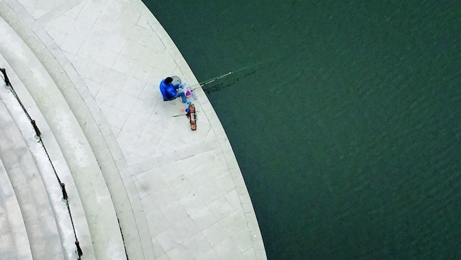 High angle view of man fishing in river