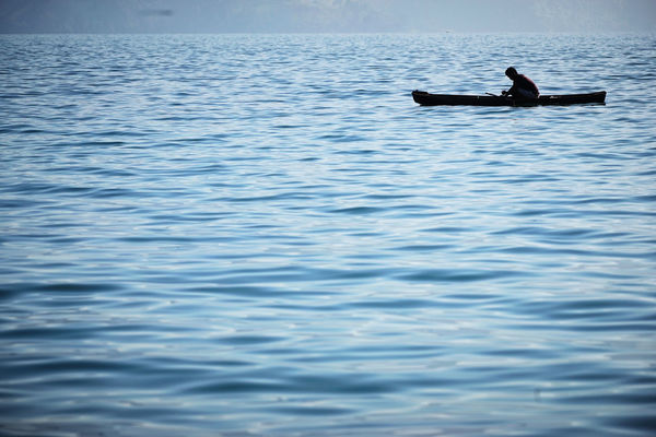 Sumatra  Toba Lake Beauty In Nature Day Full Length Lifestyles Men Nature Nautical Vessel Oar One Person Outdoors Paddleboarding People Real People Rowing Sitting Vacations Water Waterfront