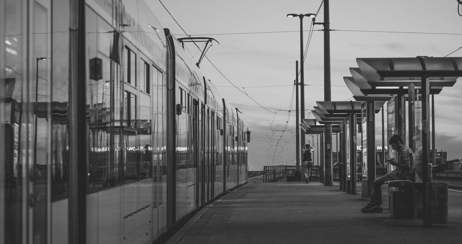Architecture Blackandwhite Budapest City City Life Composition Connection Incidental People Leading Narrow Perspective Street Streetphoto_bw Streetphotography The Way Forward Tram Transportation Walking