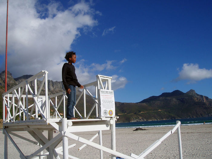 Lifesaver's lookout on Hout Bay beach. One Person Beach Boy Happy Mountain Sky And Clouds Beauty In Nature Hout Bay Beach South Africa