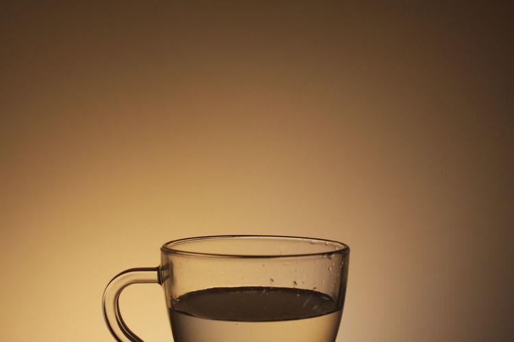 Herbal tea against beige background