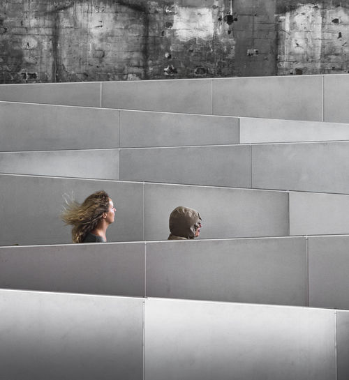 Two women passing by a zigzagging ramp in Sydney, Australia Architecture EyeEmNewHere Built Structure Headshot Lifestyles Real People Street Street Photography Streetphotography Wall - Building Feature Women The Photojournalist - 2018 EyeEm Awards The Street Photographer - 2018 EyeEm Awards