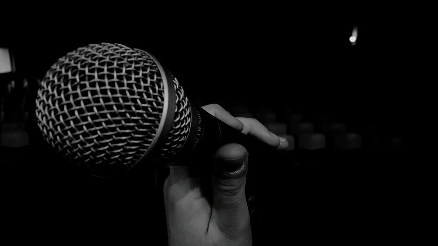 Side view of hand holding microphone