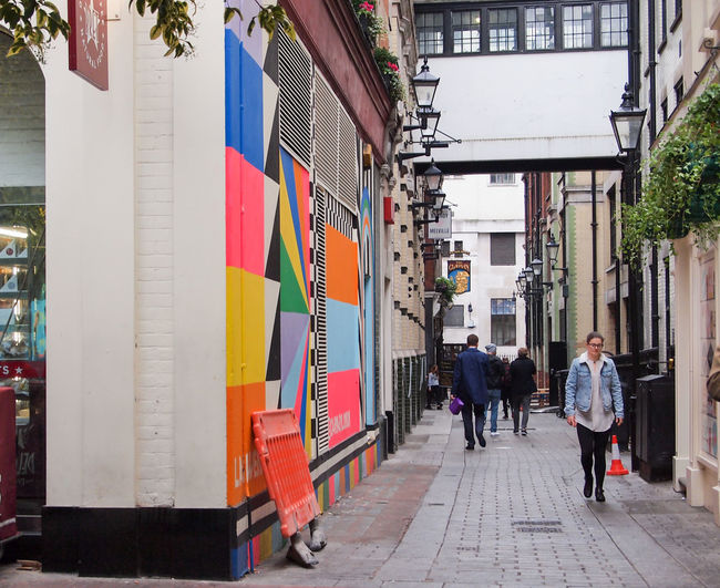 Adult Architecture Big City Life Building Exterior City Cloudy Colourful Day Multi Colored Natural Outdoors Real People Store Street Photography Streetart Walking Wall Women
