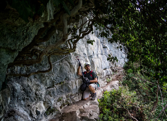 Mature man climbing on mountain