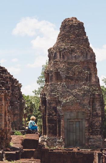 Side View Of Woman Sitting At Temple Old Ruin