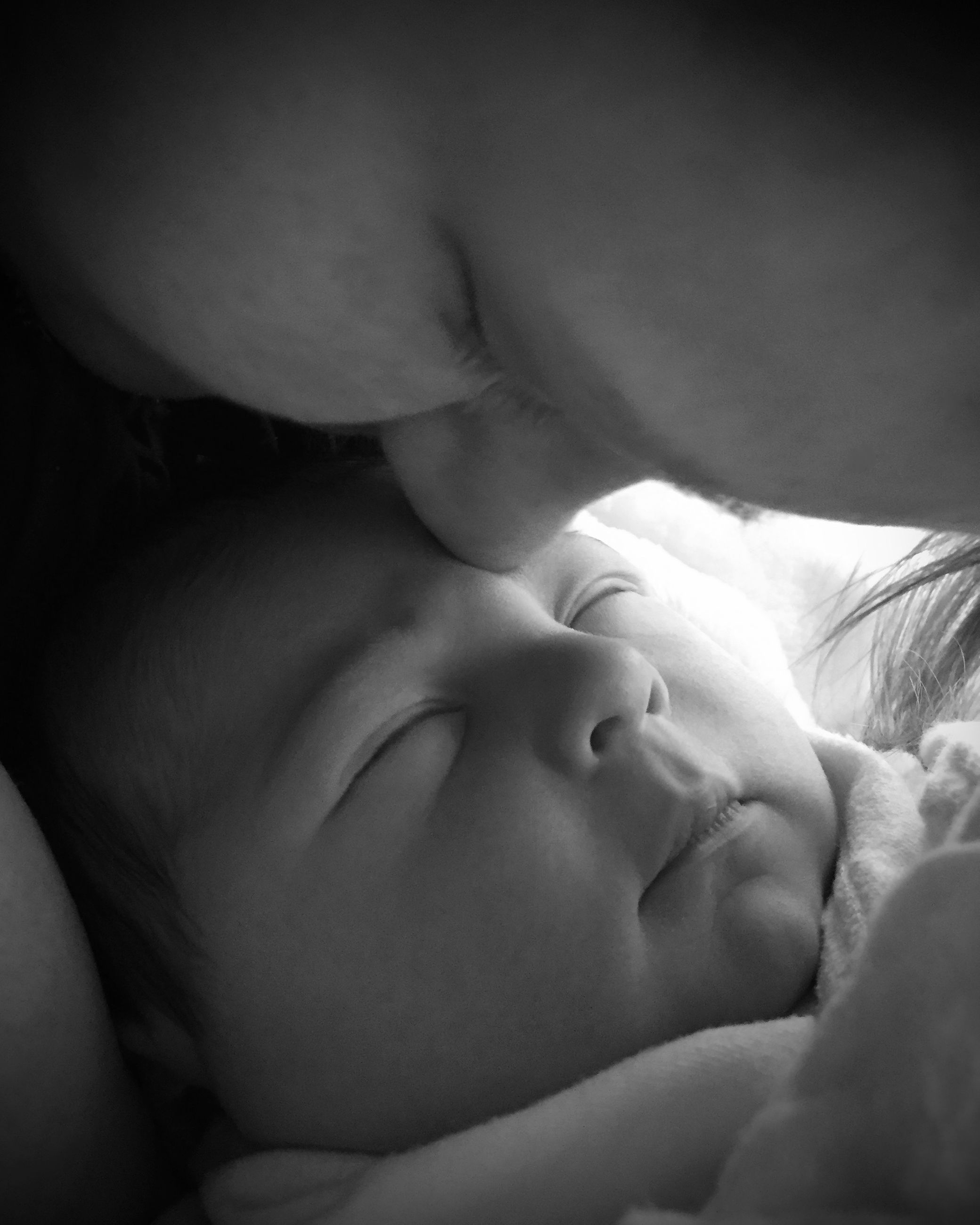 childhood, baby, innocence, babyhood, sleeping, toddler, unknown gender, lifestyles, family with one child, cute, bed, relaxation, leisure activity, lying down, family, close-up, eyes closed, beginnings, resting, new life