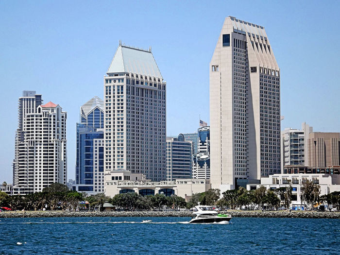 We've seen the architecture of downtown San Diego individually, now let's look at the skyline all together. Architecture Building Exterior Built Structure City Clear Sky Day No People Outdoors Sea Skyline, City, Cityscape, Waterfront, San Diego, California, Buildings, Downtown, High Rise, Boats, Harbor, Bay, Water, Shoreline, Skyscraper Urban Skyline Water