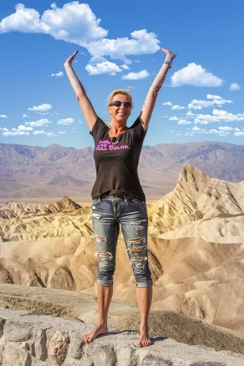 The woman that you usually find behind the lens Arms Raised One Person Sky Smiling Happiness Front View Standing Looking At Camera Day Cloud - Sky Mountain Landscape Portrait Outdoors Full Length Real People Nature Young Women Young Adult Cheerful Death Valley National Park Death Valley Zabriskie Point Tourism ThatsMe Breathing Space Mix Yourself A Good Time California Dreamin