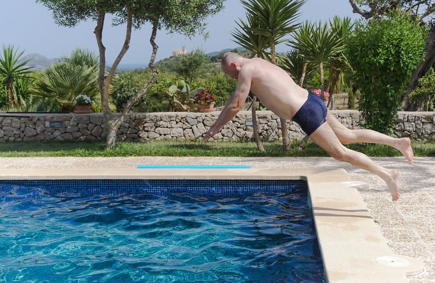 Arschbombe Blue Enjoyment Fun Fun Jump Jumping Leisure Activity Lifestyles Motion Pool Spaß Splashing Spritzen Swimming Swimming Pool Turquoise Colored Urlaub Vacations Water An Eye For Travel This Is Masculinity Summer Sports
