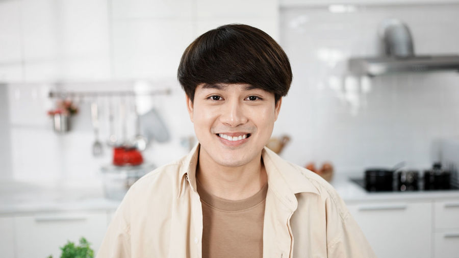 Portrait of a smiling young man at home