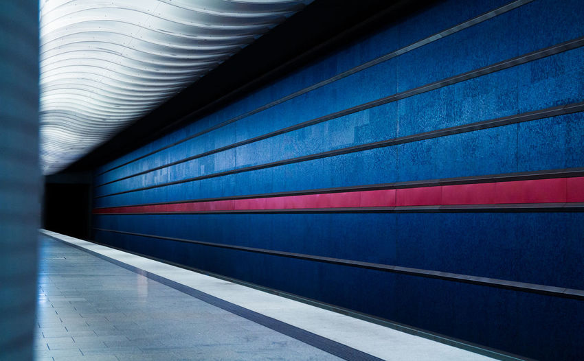 Blue patterned wall at subway station