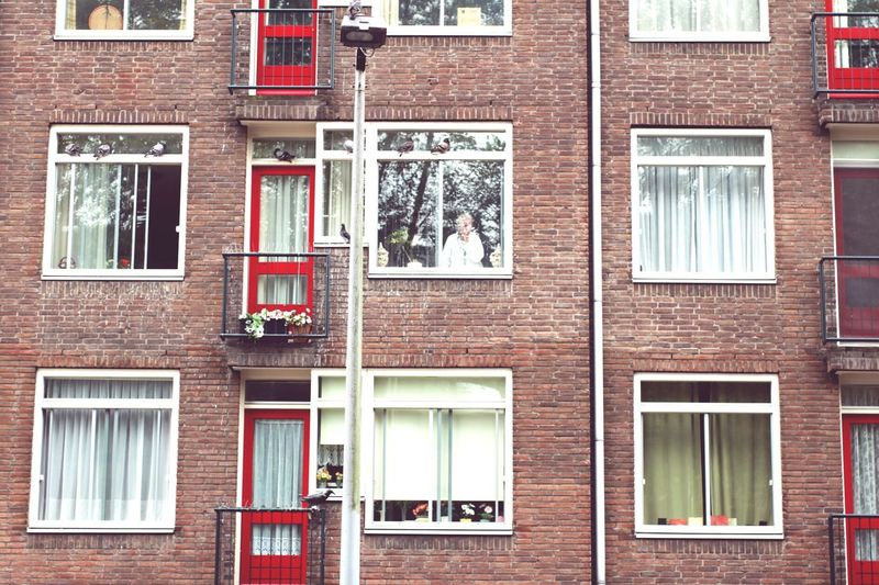 Amsterdam City Window House Woman Behind Window Citizen Alone Building Exterior Architecture Built Structure Outdoors Day Full Frame City The Graphic City
