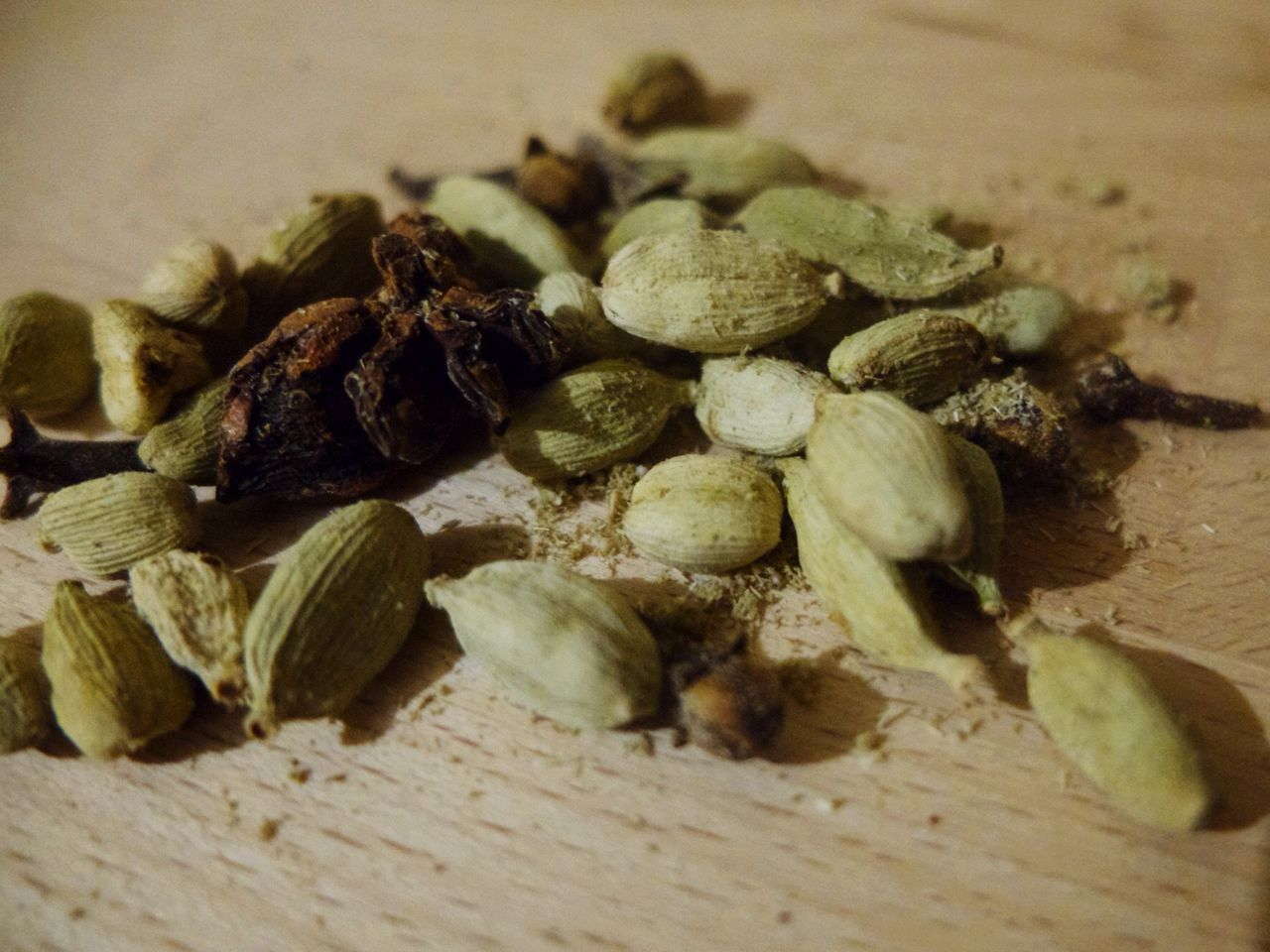 food and drink, close-up, food, still life, no people, table, indoors, selective focus, healthy eating, nut, freshness, wellbeing, wood - material, ingredient, spice, seed, large group of objects, dried food, dry, nut - food, cardamom