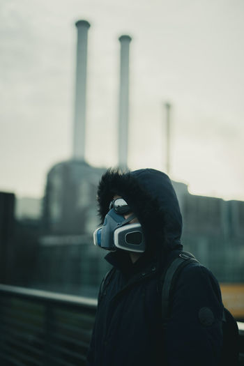 Portrait of man with mask photographing against camera
