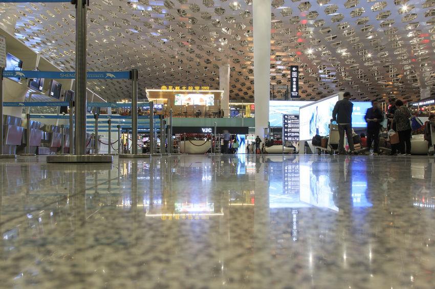 Shenzhen, China - January 5, 2016: People walking inside the Shenzhen Bao'an International Airport in Guandong, China Airplane Airport Bao'an International Airport Canton China City Life Day Guandong City Lifestyles Nature Reflection Tourists Travel Trolley Water Yunnan