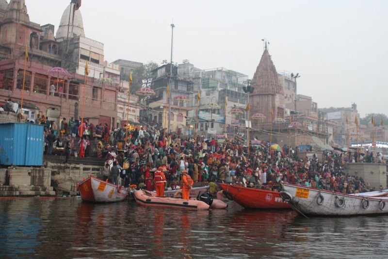 Varanasi ghats Building Exterior Architecture Built Structure Nautical Vessel Transportation City Mode Of Transportation Water Waterfront Real People Crowd Group Of People Day River Large Group Of People Outdoors