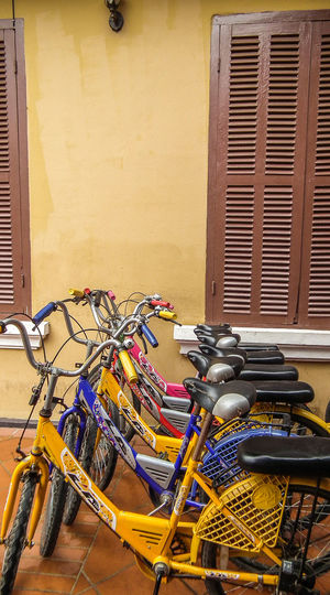 Bicycle Rental in Luang Prabang Architecture Bicycle Bicycle Rack Bicycle Rental Building Exterior Built Structure Day Land Vehicle Laos Travel Luang Prabang Mode Of Transport No People Outdoors Stationary Transportation