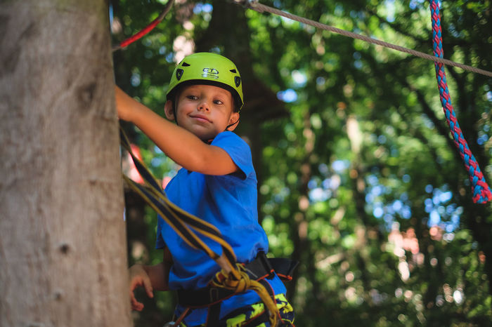 FUJIFILM X-T10 Vacations Boys Casual Clothing Child Childhood Climbing Day Focus On Foreground Fujifilm Headwear Helmet Innocence Leisure Activity Lifestyles Males  Men Nature One Person Outdoors Real People Rope Safety Harness Tree Wasiak