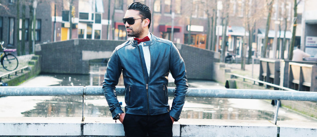 """Over 12K thank you so much! """"There are many paths to enlightenment. Be sure to take the one with a heart."""" -Lao Tzu WWW.FROCCELLA.COM for the jacket! Follow me on IG: www.instagram.com/michaelniamut/ Adult Bridge City City Life Clothes Day Froccella Grateful Happy Leather Lifestyles Love Men Model One Man Only One Person Only Men Outdoors People People Watching Portrait Tourism Travel Water Young Adult"""