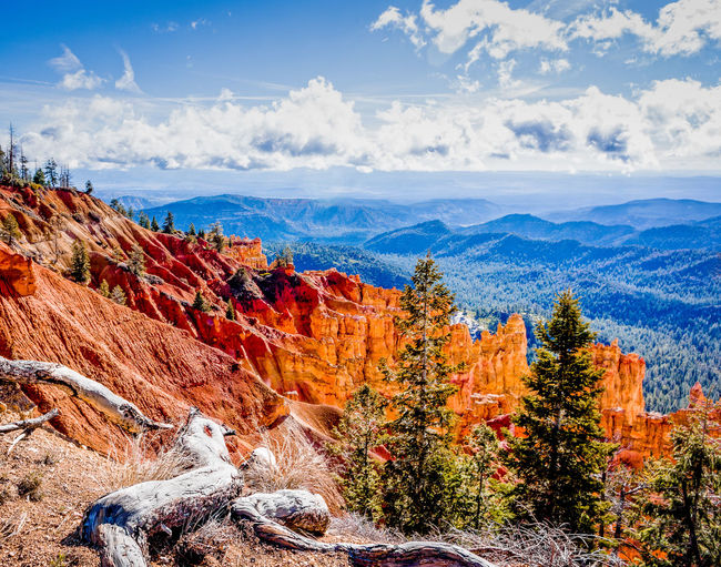 Scenic view of mountains at bryce canyon national park against cloudy sky