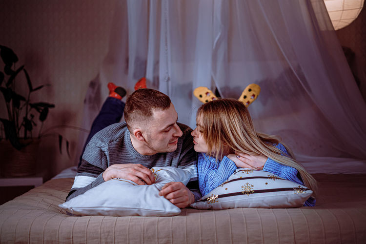 Young couple on bed at home
