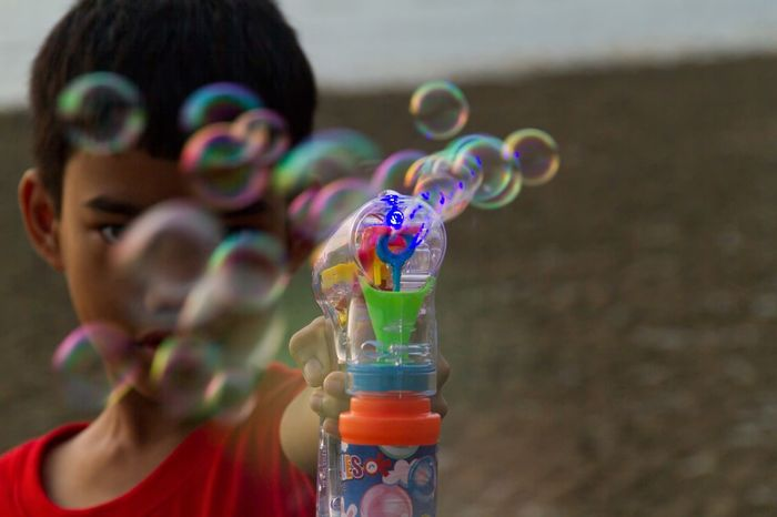 Bubbles for you Bubble Bubble Wand Focus On Foreground Multi Colored Fun Outdoors Day Close-up One Person Visual Creativity
