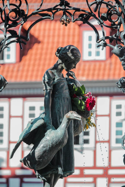 Gänseliesel Gänseliesel Göttingen  Architecture Art And Craft Building Building Exterior Built Structure Craft Creativity Cultures Day Flower Flowering Plant Focus On Foreground Germany Human Representation Low Angle View No People Outdoors Plant Portrait Representation Sculpture Statue Window