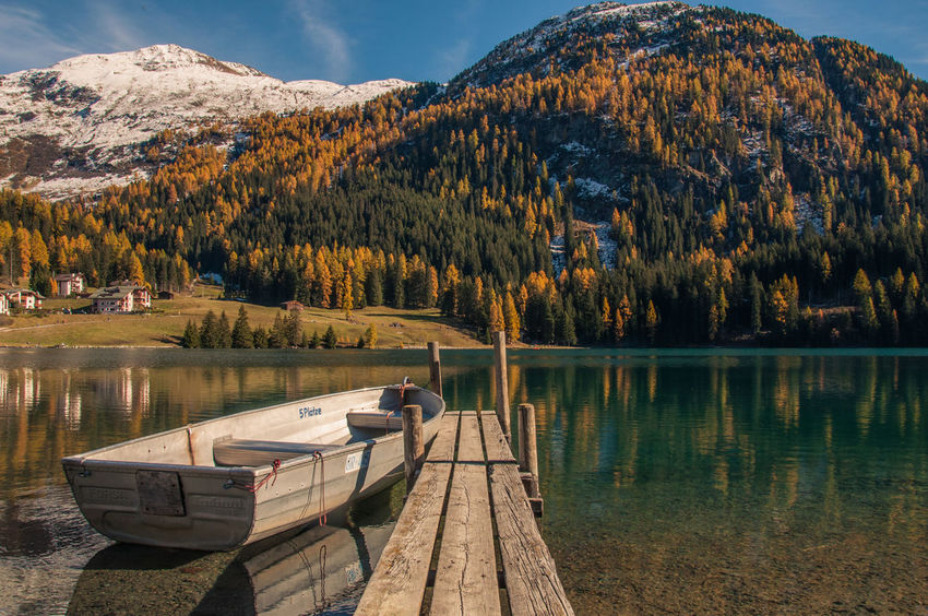 Ready to go ;) Autumn Autumnlove Beautiful Beauty In Nature Boat Boattrip Davos Lake Landscape Mountain Mountain Range Mountains Nature No People Outdoors Pine Woodland Reflection Reflection Reflections Switzerland Tranquility Vacations Water Wilderness