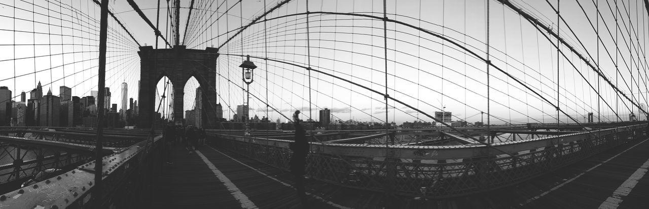 Panoramic view of suspension bridge against sky