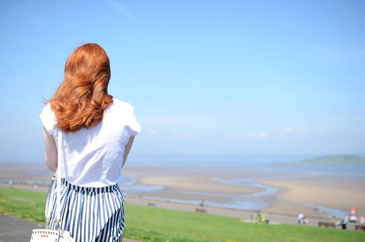Edinburgh Scotland Woman Beach Beachday Casual Clothing Clear Sky Crammond Grass Leisure Activity Lifestyles One Person Real People Rear View Redhead Sea Sky Standing Summer Sunshine Water Women Young Adult Young Women